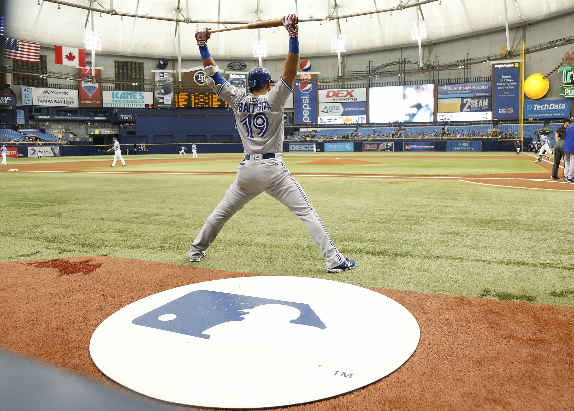 Sep 4, 2016; St. Petersburg, FL, USA; Toronto Blue Jays right fielder Jose Bautista (19) stretches while on deck to bat prior to the game against the Tampa Bay Rays at Tropicana Field. Mandatory Credit: Kim Klement-USA TODAY Sports