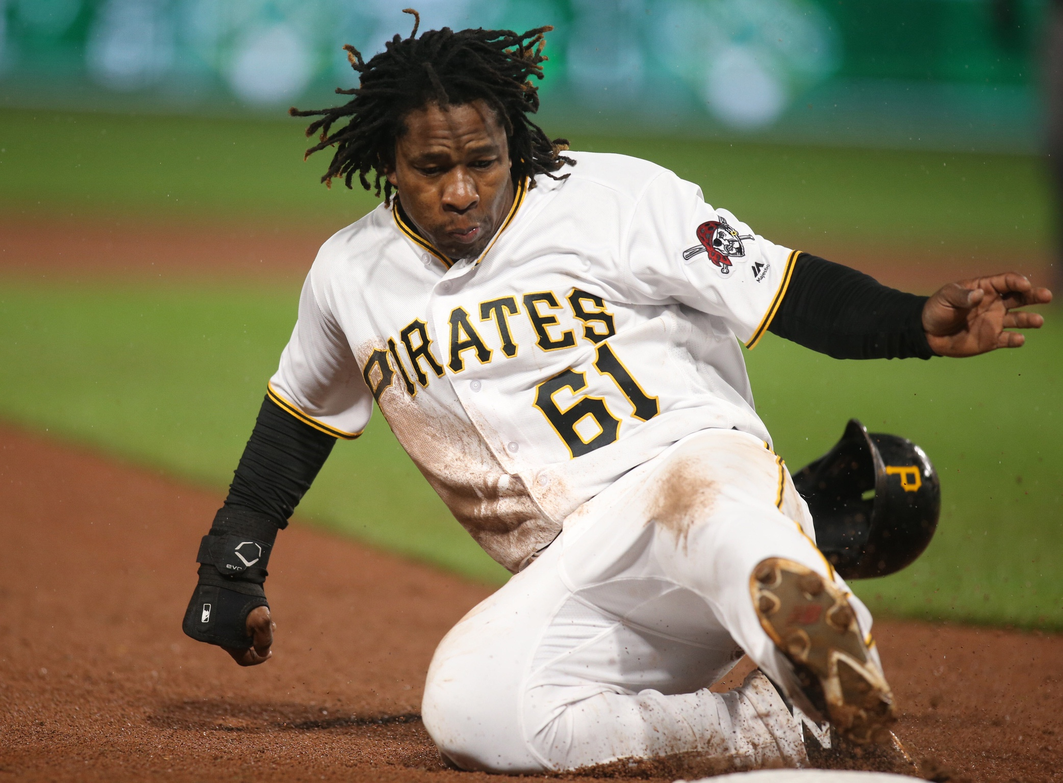May 6, 2017; Pittsburgh, PA, USA; Pittsburgh Pirates second baseman Gift Ngoepe (61) advances to third base against the Milwaukee Brewers during the tenth inning at PNC Park. Mandatory Credit: Charles LeClaire-USA TODAY Sports